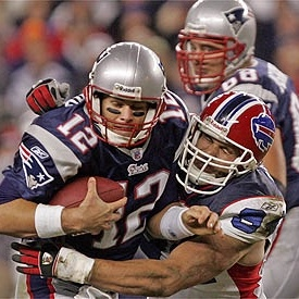 Bills DE Aaron Schobel with one of his 12 career sacks of Tom Brady